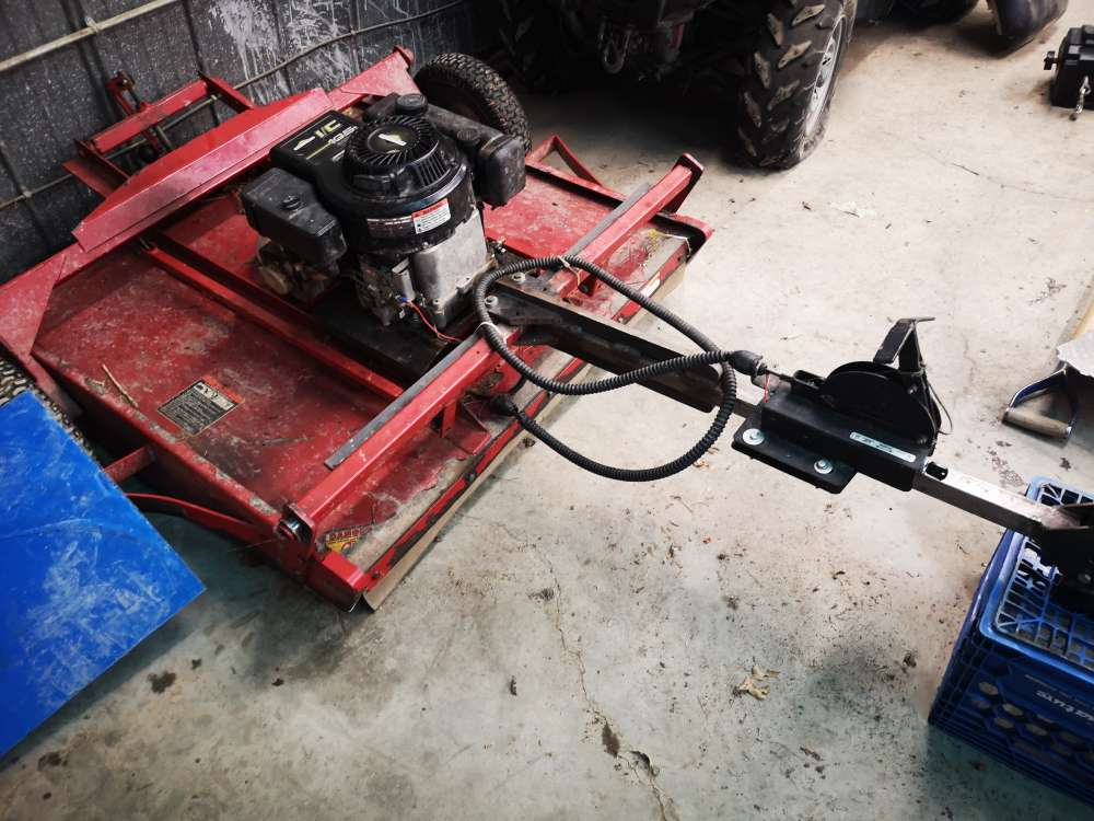 Tractable land mower